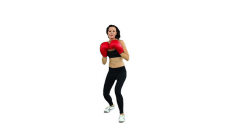 Fit brunette boxing with red gloves Footage