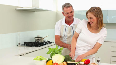 Mature smiling couple making healthy dinner togeth Footage