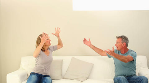 Mature couple having a fight on the couch Footage