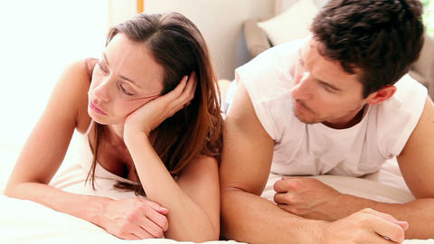 Unhappy couple lying on bed not talking Footage