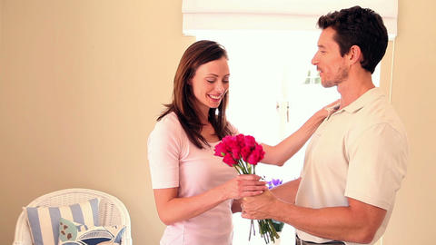 Man surprising his girlfriend with roses Footage