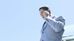 Businessman speaking on phone outdoors Footage
