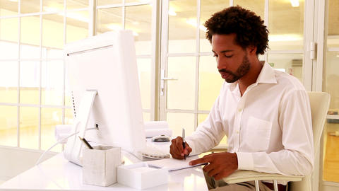 Businessman taking notes at his desk Footage
