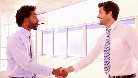 Businessmen shaking hands and smiling Footage