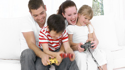 Family at home playing Video games on the sofa Footage