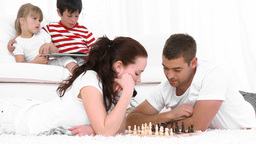 Young Couple Playing Chess in the living room Footage