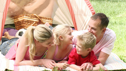 Family camping relaxing on the grass Footage