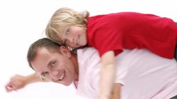 Dad giving his son piggyback ride Footage
