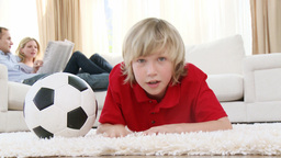 Kid watching a football match in television on flo Footage