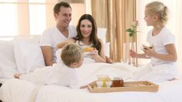 Family having healthy breakfast in bed Footage