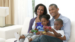 AfroAmerican family playing video games at home Footage