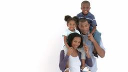 AfroAmerican parents giving their children piggyba Footage