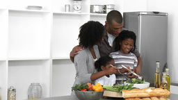 AfroAmerican family preparing a salad in the kitch Footage
