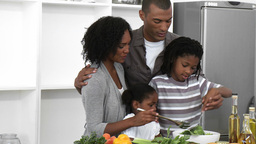 Panorama of AfroAmerican family preparing a salad  Footage
