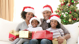 AfroAmerican family with Christmas gifts on the so Footage