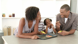AfroAmerican family eating confectionery in the ki Footage