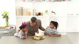 Ethnic dad and children celebrating a birthday Footage