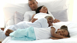 AfroAmerican children sleeping with their parents Footage