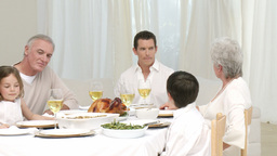 Panorama of family talking at their Christmas dinn Footage