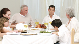 Family talking at their Christmas dinner Footage