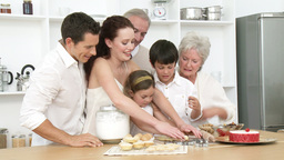 Parents, grandparents and children baking in the k Footage