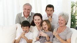 Family singing karaoke at home Footage