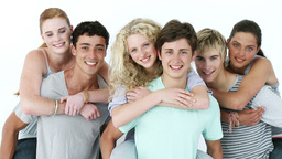 Male teenagers giving their friends piggyback ride Footage