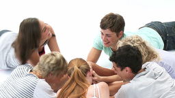 Teens playing on the floor hands games Footage