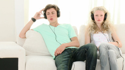 Teen Couple relaxing listening to music Footage