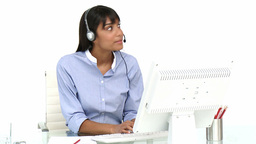 Ethnic businesswoman using headset Footage