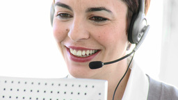 Attractive business woman working in a call centre Footage