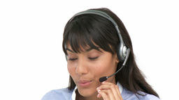 Smiling business woman using headset Footage