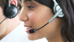 Smiling ethnic businesswoman with headset on Footage