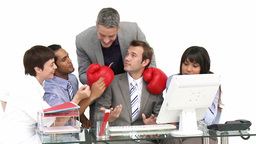 Mature manager wearing boxing gloves in a meeting Footage