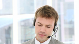 Smiling businessman using a headset Footage