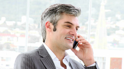 Mature businessman calling by phone Footage