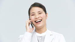 Asian businesswoman talking on phone Footage