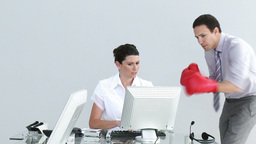 Competitive businessman talking to his colleague wearing boxing gloves Footage