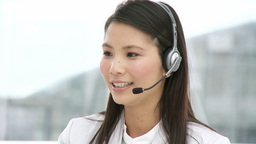 Pretty businesswoman with headset on Footage