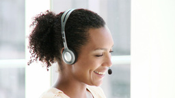 Enthusiastic businesswoman with headset on Footage