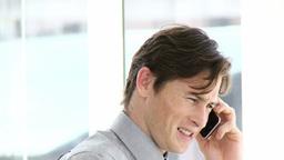 Positive businessman talking on phone Footage