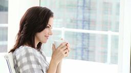 Pretty businesswoman drinking coffee Footage
