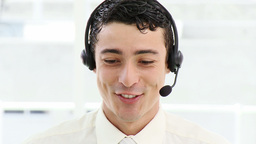 Smiling businessman with headset on Footage