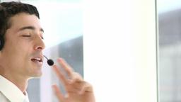 Portrait of handsome customer service representati Footage