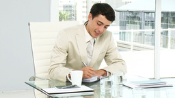 Concentrated businessman writing in his agenda Footage