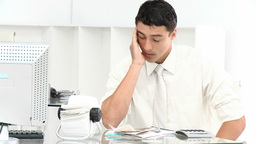 Young businessman stressed with so many bills to p Footage