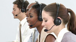 Business group showing ethnic diversity in a call center Live Action
