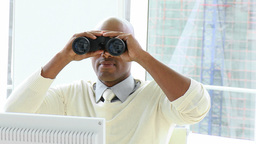 Ethnic businessman looking through binoculars Footage