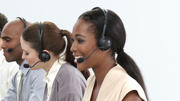 Young customer service representatives using heads Footage