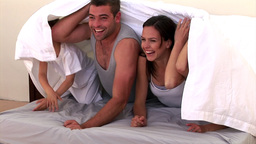 Adorable family hiding on the bed Animation